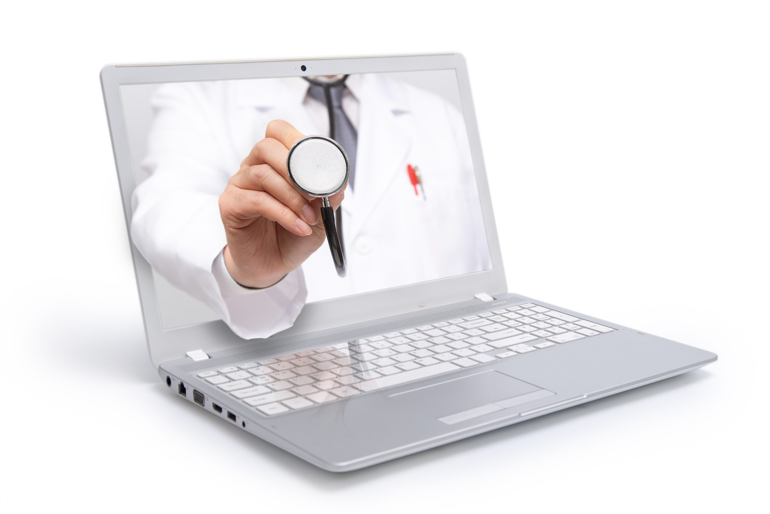 A doctor's stethoscope reaches through a computer screen, representing the medical care that is provided online via telemedicine or telehealth services.